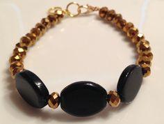Black and gold handmade bracelet Www.facebook.com/BayouBlingLA