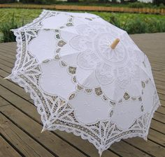 Great idea for Brides and party if it is going to be hot and sunny.  Battenburg Lace Umbrella Wedding Bridal Parasol on Etsy, $19.99