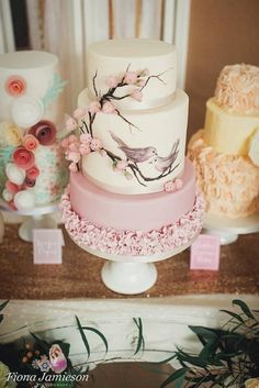 Pink ruffles with cherry blossoms and hand painted birds. Photo credit Fiona Jameison Photography