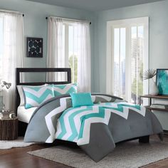 Add a pop of color to your bed with the eye-catching Cade Reversible Comforter Set. Decked out in an aqua and grey chevron design and solid grey reverse, the bold bedding is a fun and funky addition to any bedroom. Gray Bedroom, Bedroom Sets, Bedroom Decor, Master Bedroom, Bedding Decor, Dorm Bedding, Modern Bedroom, Aqua Bedding, Chevron Bedding