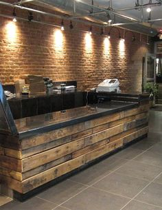 DIY Store counter. Made from pallets. Thinking maybe an old bar could be lined with the old wood, then add a day!!  I think this would be a great idea for Gretchen dining room.. love it.. I'll help in July...lol