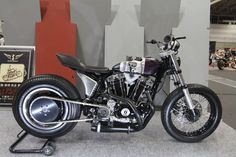 Ironhead Sportster flat tracker with vertical velocity stacks exiting through gas tank