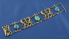Art Nouveau Black Opal and Emerald Bracelet, composed of bezel-set opals joined by scrolling foliate links, emerald bead and freshwater pearl highlights, completed by a conforming clasp, lg. 7 1/2 in