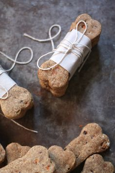 Carrot & Banana Natural Dog Treats  2 1/2 cups whole wheat flour  1/2 cup cornmeal  1 bunch fresh carrots, finely chopped or grated  2-3 fresh bananas, peeled and mashed  1 beaten egg  1/3 cup vegetable oil  1 tablespoon brown sugar (*optional, we went without)  1/2 cup cold water  After baking 35 min at 350 degrees, turn oven off and leave cookies inside for another 30-45 minutes until crisp