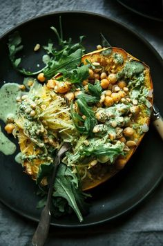 Low-fuss and cozy vegan recipe. Stuffed spaghetti squash is hearty and delicious with chickpeas and a garlicky arugula (cashew-based) cream. 10 ingredients!