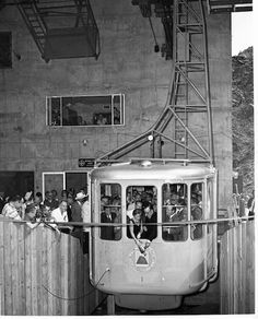 On Sept. 12, 1963, 400 dignitaries came from all over the world to be part of the inaugural ride of the Palm Springs Aerial Tramway. They paid $1,000 each to take a breathtaking journey up the cliffs of Chino Canyon to the top of Mt. San Jacinto. Gov. Edmund Brown's wife, Bernice, christened the first tramcar by breaking a bottle of California sparkling wine on the side of the car. Aerial Tramway, San Jacinto, Coachella Valley, Sparkling Wine, Palm Springs, All Over The World, Places To See, Paradise, Photo Wall