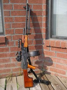 RPK which is an AK variant w/Drum,chambered in 7.62 X 39 which is the same round used in the AK and SKS. Woof.