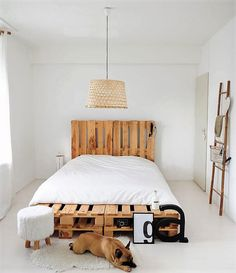 You may build this simple DIY pallet wood bed if you are an easy going person. The white walls are having awesome impact with the natural wood colour and texture of the bed. The base of the bed has been extended to the foot to provide space for keeping a few of your essential belongings.