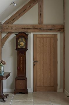 oak board door with painted architrave and skirting