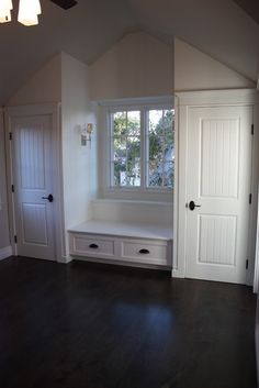 Attic Efficiency Apartment - living area ideas. Closets on each side of a window seat.