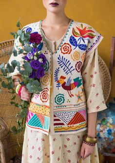 """""""Frida"""" waistcoat in linen/cotton A wonderful waistcoat full of gorgeous embroidery of flowers, leaves and birds offset by strict geometrical shapes and concealed button-fastening. A pattern celebration in full bloom! Standard fit. Article number 67607"""