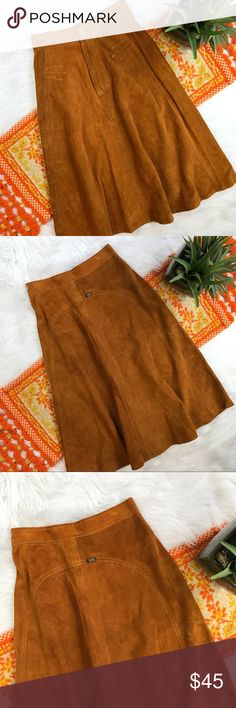 Vintage 1990s leather Suede Midi skirt How adorable?!? Fits a size 2. In good vintage condition, does have some markings on it as shown in photos! Length-27.5, waist-13 straight across *** no modeling or trades! Vintage Skirts Midi