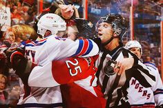 """""""Chris Neil and Brandon Dubinsky have it out with each other…. using their lips."""""""