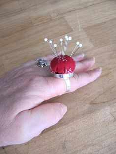 Pincushion ring - Like the idea, but it could be made entirely from bio-degradable materials. OK, maybe not so pretty, but less expensive and trash-able!