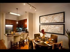 luxury apartments transitional dining rooms and dark cabinets