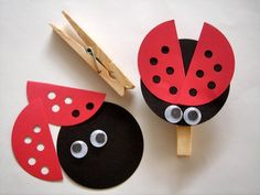 ladybug clothespin: black diecut circle, red die cut circles cut in half with hole punched holes throughout, googly eyes glued on a clothespin