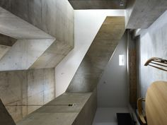 House in Nishiochiai is a minimalist house located in Tokyo, Japan, designed by Suppose Design Studio. The home features a concrete construc...