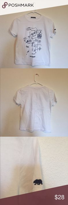 Brandy Melville Jamie map top Soft cotton crewneck tee in white with the LA map graphic printed. There's a small navy color CA bear embroidery on the left sleeve! Should fit xs-s! Brand new, never worn or washed. **NO TRADES** Brandy Melville Tops Tees - Short Sleeve