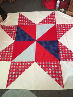 My BIG red/white/blue star quilt. I'm going to back it in Texas bluebonnet fabric and it will be our picnic quilt to watch fireworks by in 2015.