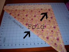 How to fold fabric for cutting bias strips!    That girl... That quilt: Rounded Quilt Corners {a bias binding tutorial}