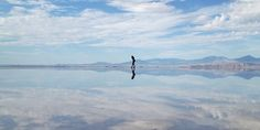 There are so many natural wonders to visit in America -- but the Bonneville Salt Flats are perhaps one of the most eye-catching, unique spots in the U.S.  Bonneville Salt Flats is a densely packed salt pan located in Tooele County of northwestern Utah and is one of the largest salt flats in America.