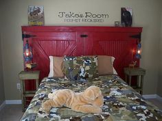 How precious for a little boy!  I love the barn door as a head board and of…