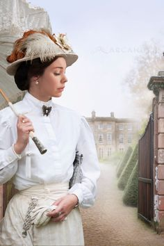 edwardian woman at the approach to a mansion houseBY: Lee Avison