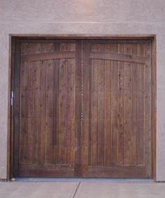Clopay reserve collection custom wood carriage style garage door we custom build wood garage doors wood sided garage doors in denver co we design build install repair wood garage doors solutioingenieria Choice Image
