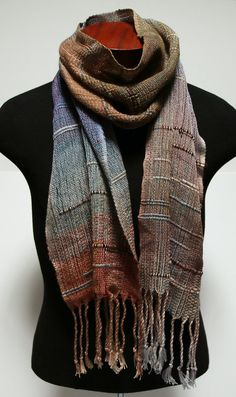 This scarf is based on a saori style of weaving, where there is initially no…