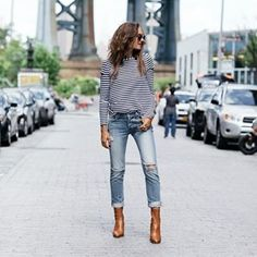 @shalicenoel knows how to wear the nautical trend. She keeps her look on point with block heeled ankle boots, perfect for parading the New York streets. For fall match this look with a brown or beige shearling coat.Jeans: #rails_la, Boots: #TopshopStyle, Strip Top: #lovephilosophy.http://www.justthedesign.com/outfits/fall/fashion-trends-must-2016-fall-outfits/#fashion, #fashionista, #fashionblogger, #streetstyle, #fashionicon, #instastyle, #instafashion