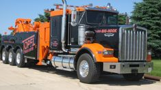 KENWORTH W900 high hood and a Miller side pull unit.