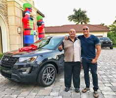 """Dwayne """"The Rock"""" Johnson surprised his dad, former professional wrestler Rocky Johnson, with a new car for Christmas.  When the cops arrived, Johnson said his mother was given an ultimatum: either her son stays, or the new boyfriend stays."""