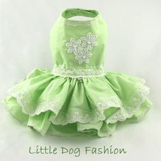 * Dog fashion for small dogs, handmade * Dog harness dress, custom made * Formal dog dress features a mint green chintz fabric * Beaded dress also features a double ruffle and is very full * Perfect dog flower girl dress or formal dress for Easter * Closes around neck and girth with velcro * Dog dress is decorated with lace at hem, girth and around neck * Lace at girth and top hem is hand beaded * Each bead is individually sewn and secured to the dress * d ring for easy leash attachment…