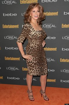 The 73 year old actress Rachel Welch opted for a leopard print, curve-hugging dress that showed her famous hour-glass figure. She paired the look with some strappy gold sandals and simple hoop earrings.