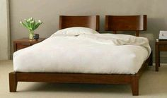 Bed with chair backs as headboard. ... cool?