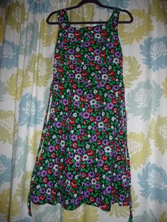 Description:Immaculate cotton dress. Zips at back and has ties at the back.Approx 1975 The label states: St Michael size 16 Eur 44Made in the UKTo fit bust 97 cm 38 inches, hips 102 cms, 40 inches.Measurements (measure laid flat):across chest 16 inches /  41.5 cmsacross waist 14.5  inches / 37.5 cmsShoulder to hem 39  inches / 100 cmsPostage/Packaging:We will try to use recycled packaging or the most cost effective packaging. If you would like the item ...