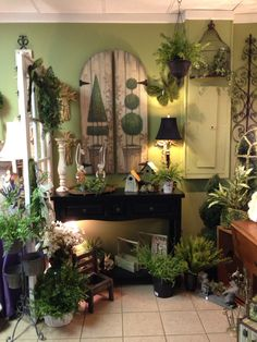 I love the topiaries painted on the old shutters always a great look I change a lot  of my displays