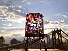 Tom Fruin's WATERTOWER  June 2012 - June 2013    The prime viewing locations are the Brooklyn Bridge Park at Washington Street(see map), and the Manhattan Bridge bike path.  http://www.tomfruin.com/watertower.html