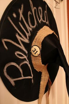 Hanging a witches hat on the door!