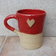 I threw this mug on my pottery wheel using strong rustic stoneware clay, added a little heart stamp, and finished it in a lovely bright red speckle glaze.  Dimensions--11cm high and 9cm across the rim.  Weighs 410gms and hold 380mls.  Foodsafe glazes.....