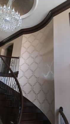 Large Acanthus Trellis Stencil from Royal Design Studio on staircase feature wall. Stenciling in metallic pearl.