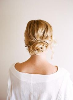 Spin pins are every hairstylist's secret weapon. You only need one to secure this easy twisted updo. #weddinghair #mediumhair