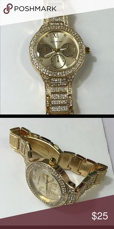 Eye catcher gold watch Flashy gold watch with crystals all over it Accessories Watches