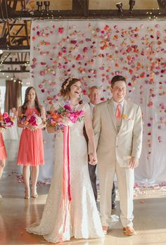 Brides.com: . If you're trying the knot in a spacious, loft-like venue, create a focal point for the ceremony like this couple did by draping fabric from the rafters and stringing flowers to create an artful curtain of fresh blooms. Created by Bows + Arrows.