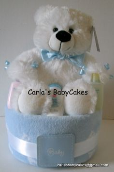 Sampler Diaper Cake for baby shower  Designed  with the first time mom to be in mind.  Includes the top 3 brands of disposable diapers along with other goodies.  Price:  $27.00 plus shipping, $27