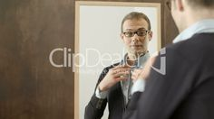 Young man dressing up, looking at mirror in fashion shop: Royalty ...