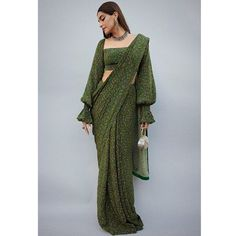 Masaba saree perfect for diwali adorned by Sonam Kapoor Bonafide Fashionista : Sonam Kapoor looks like the epitome of elegance in this emerald printed saree by Masaba. WhatsApp us now for personal shopping experience! Indian Fashion Dresses, Dress Indian Style, Indian Designer Outfits, Indian Fashion Trends, Indian Fashion Modern, Indian Designers, Fashion Outfits, Stylish Blouse Design, Fancy Blouse Designs