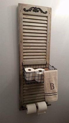 Perfect! An old shutter repurposed to hold the extra toilet paper rolls.