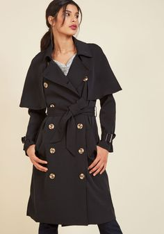 Astonish With Polish Trench | Mod Retro Vintage Coats | ModCloth.com  Let this black trench be your ticket to a legacy of awe-inspiring style! Layer up casual looks with the capelet shoulders and marbled buttons of this pocketed garment for a refined twist, or bolster your fancier duds with timeless silhouette. You can't go wrong with a piece this chic!