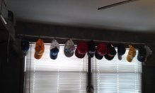 a handy and inexpensive way to curtain a teenage boys room. All of their hats hung from hooks on the curtain rod. Saves the cost of those expensive curtains and easy for them to grab a hat to wear !! Plus they get to show off all of their hats.. bonus!
